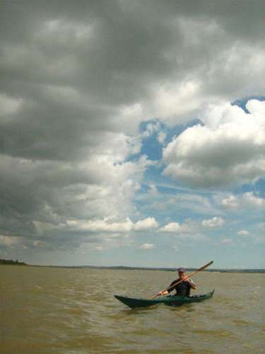 Sea kayak under stormy sky