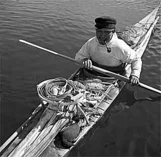 Inuit kayak with hunting equipment