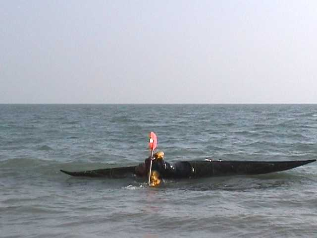 One of sequence of kayak rolling photos