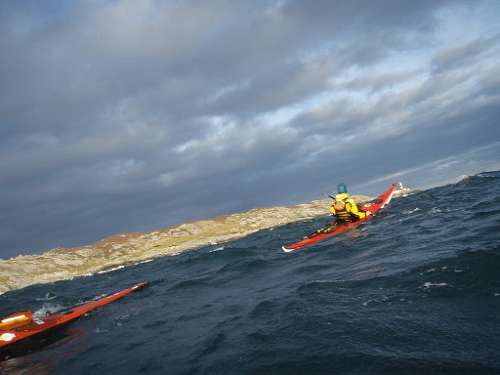 Kayakers rounding the point