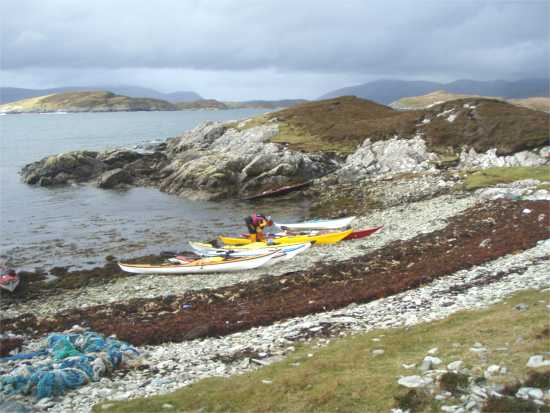 Kayaks on beach, NW Scotland