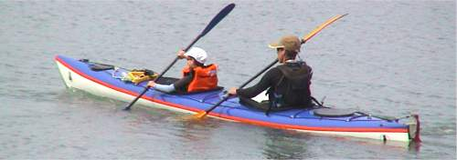 Adult and child in touring double kayak