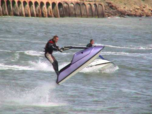 Jetskiers showing off 3