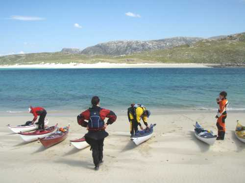 Kayakers on beach in NW Scotland